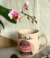 Mug with a drawing of a cat inspired by the famous female painter Frida Kahlo
