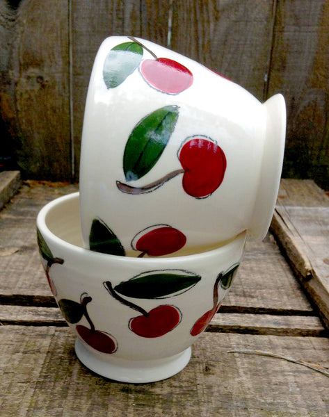 Two coffee cozy bowls handmade and handtrown made of porcelain with cherries pattern