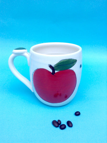 Mug, with hand-painted apple pattern.