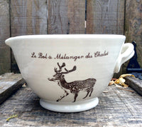 Mixing bowl with spout and handle with a deer