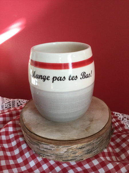 "Nice hot chocolate glass. Beer or coffee mug , Quebec expression "" Mange pas tes bas! "" . Made of porcelain handpainted. in Quebec"