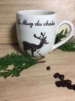"Coffee mug of the cabin with a deer and a french inscription ""le mug du chalet"""
