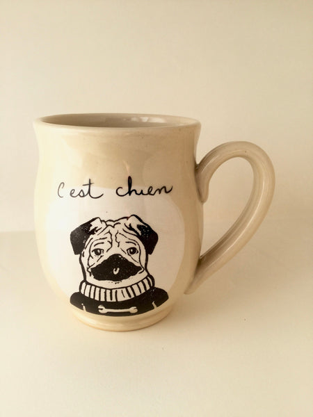 "Pug mug "" made of hand-turned porcelain clay with a dog design and french inscription ""C'est chien"" left handed or right handed available"
