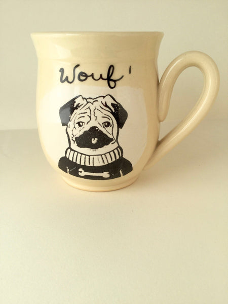 "Pug dog mug, made of hand-trowned porcelain. Dog design with an inscription ""Wouf"" left handed or right handed available"