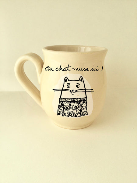 "Cat mug, made of hand-trowned porcelain.cat design with an inscription ""On chat muse ici!"" left handed or right handed available"