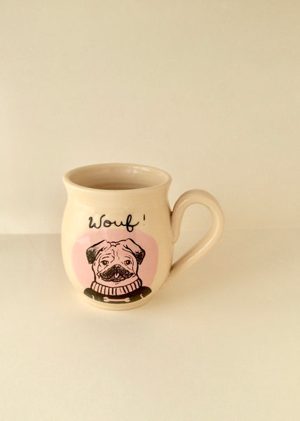 "Pug mug love "" made of hand-turned porcelain clay with a dog a pink round design an inscription ""Wouf"" left handed or right handed available"