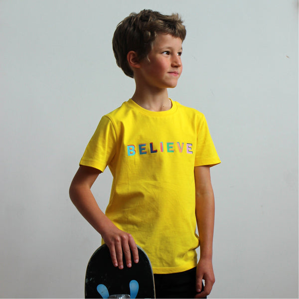 believe tee shirt in yellow