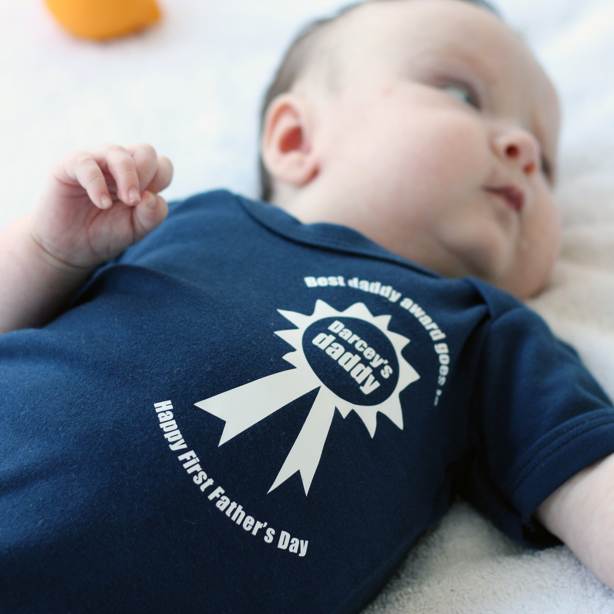 First Father's Day Rosette Personalised Baby Grow