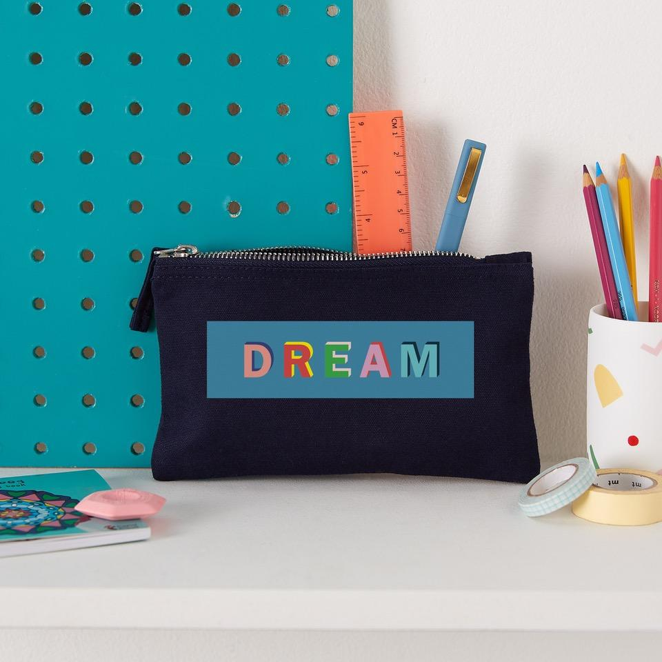 navy pencil case with the word dream printed on it
