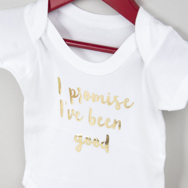 close up of personalised first christmas babygrow