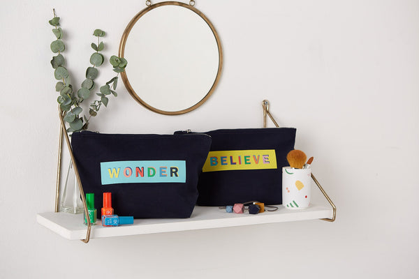 wonder and believe make up pouch on a shelf