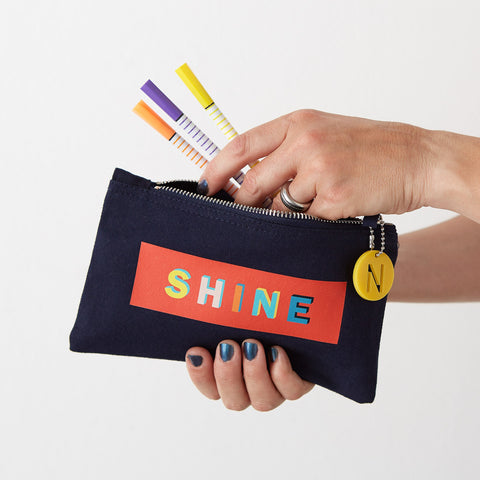 navy pencil case with the word shine printed on it