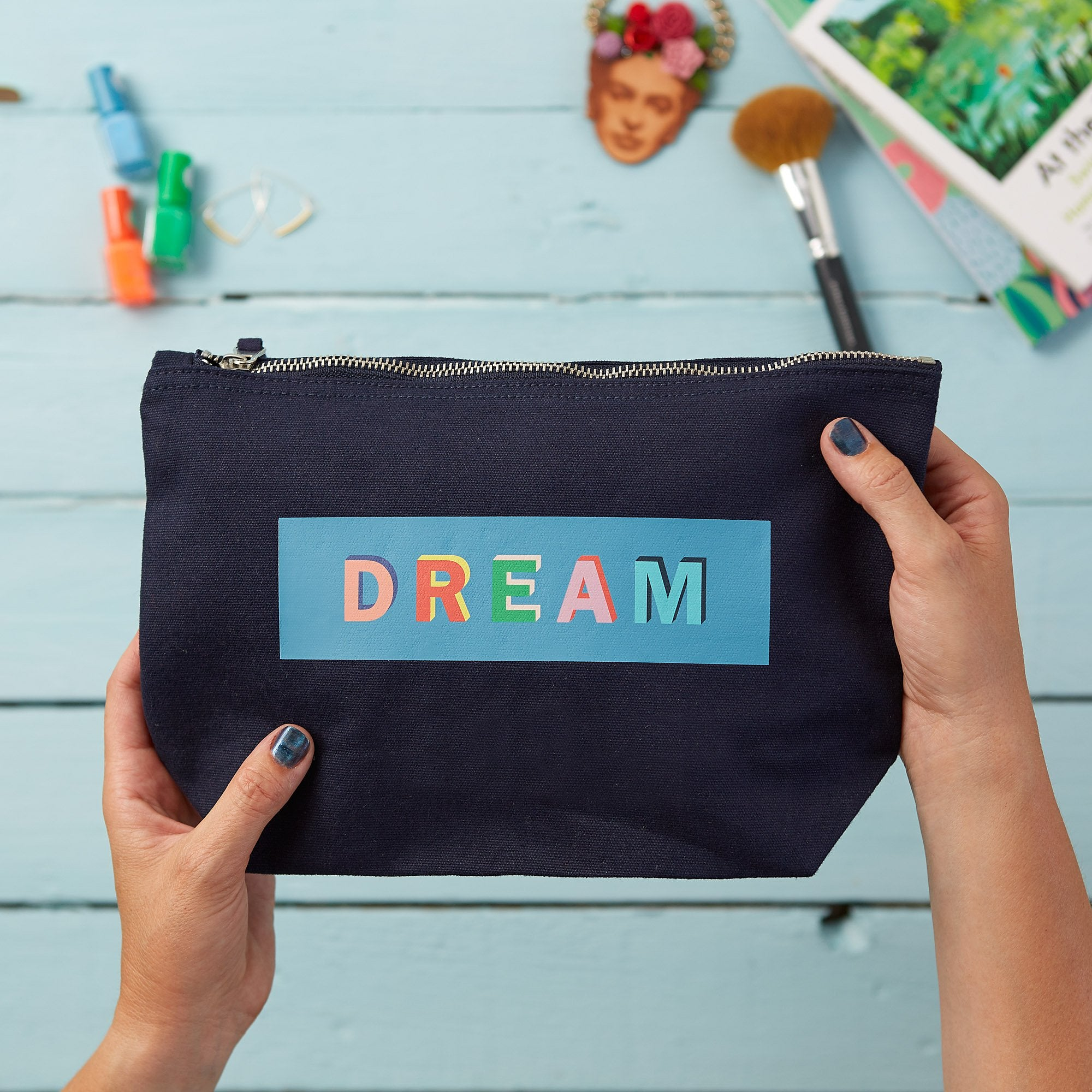 make up pouch with dream printed on it