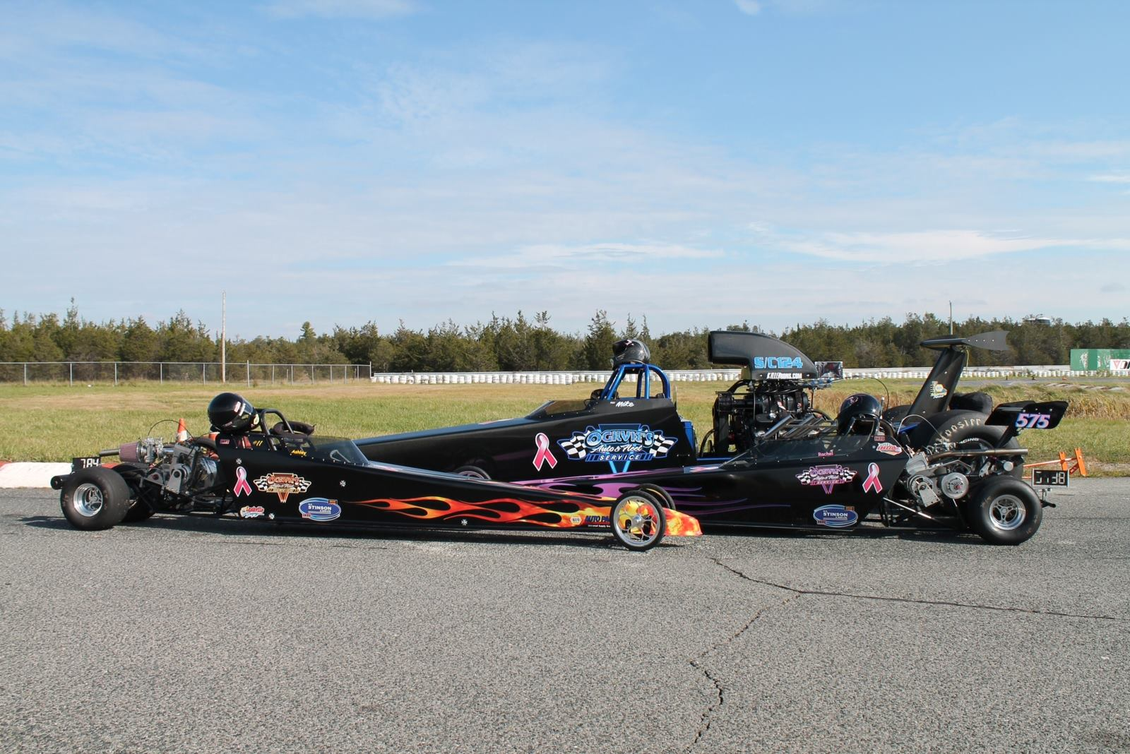 dragster and two junior dragsters parked