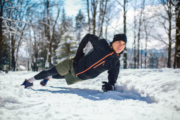 Guy doing abs in snow