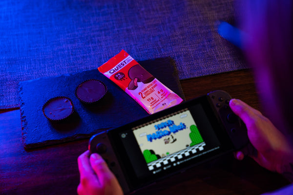 Playing Mario Bros while eating Quest PB cups