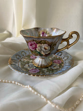 Load image into Gallery viewer, Vintage Sterling Iridescent Teacup and Saucer with Textured Pansy Flowers