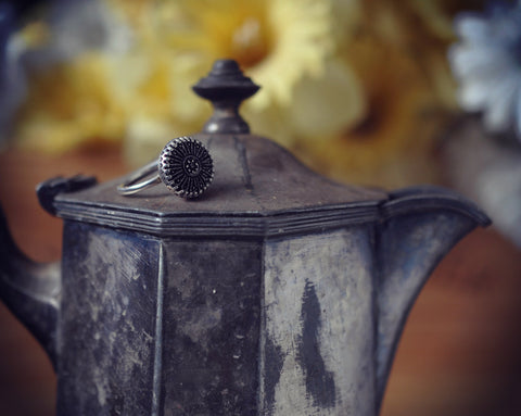 Black glass button ring