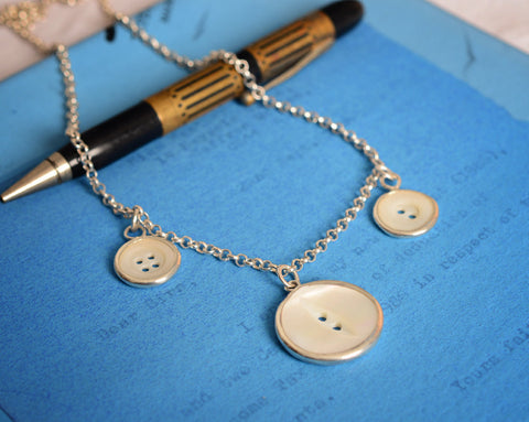 Three button necklace