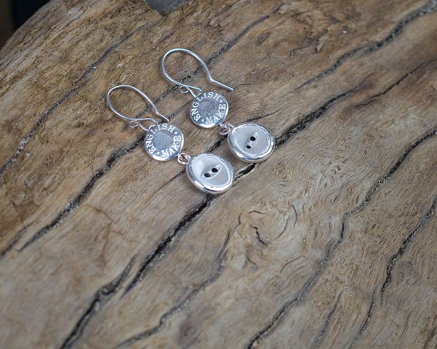 English make drop earrings with button