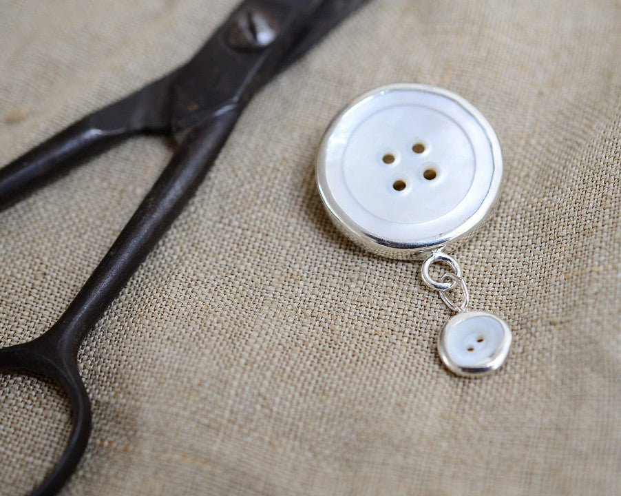 Two button brooch
