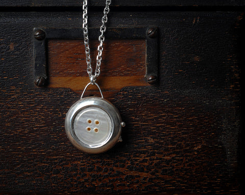 Mother of pearl button locket necklace
