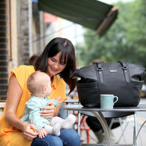 Babymel award winning nappy bags | Anya vegan Leather black | Mum holding baby with bag by her side