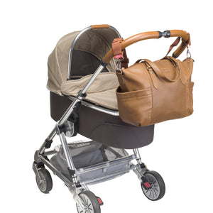 Babymel nappy bag Anya Tan vegan leather, on pram , tan faux leather baby bag handbag.