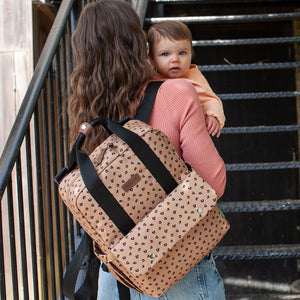 Mum with Babymel eco nappy bag convertible backpack, Georgi Caramel Leopard, front view, recycled material, animal print changing baby bag