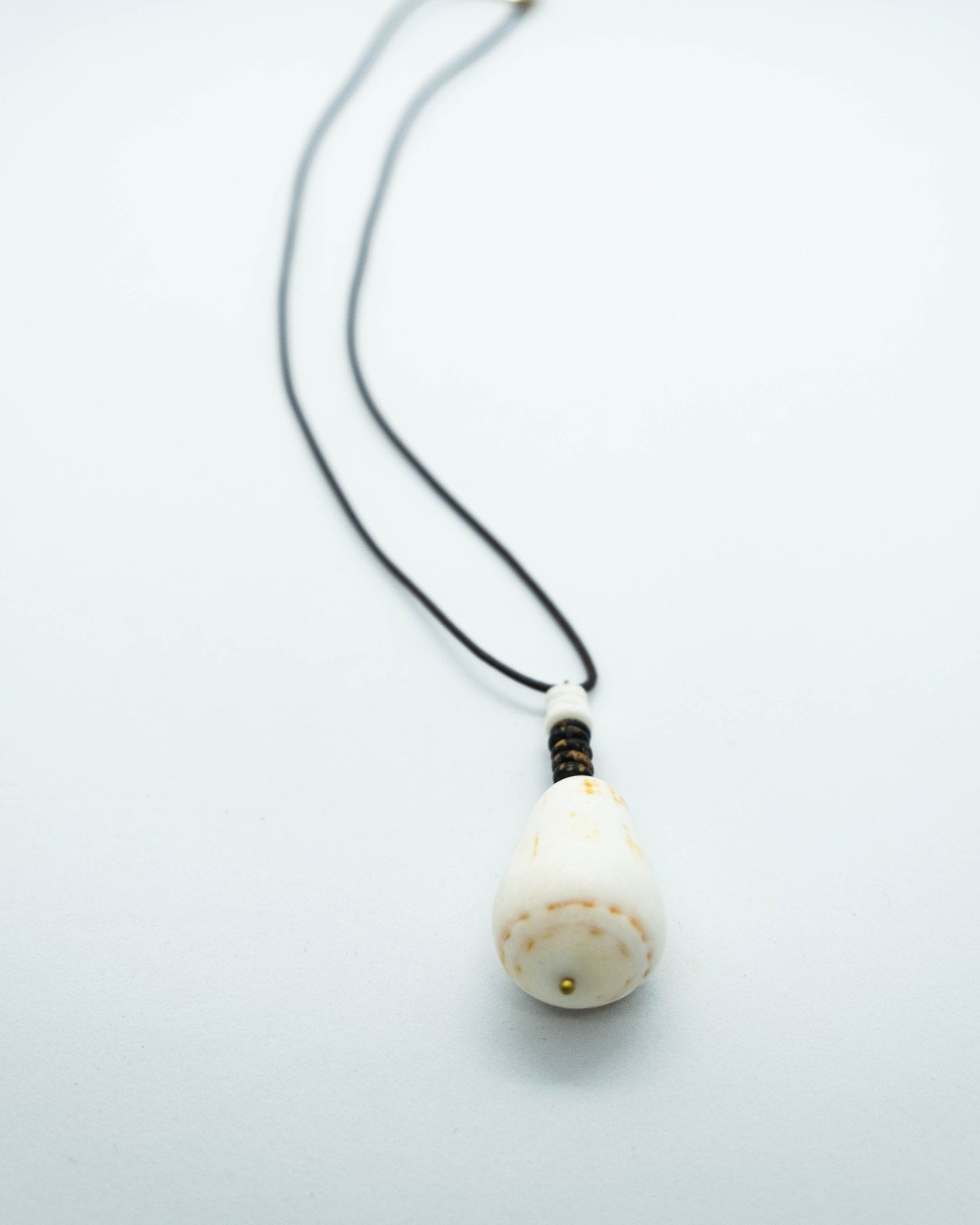 Cone Shell on Brown Leather Cord