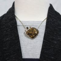 amphibole brown handmade sterling silver pendant with gold accents