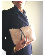 Load image into Gallery viewer, palest pink shearling pouch with black leather wristlet.