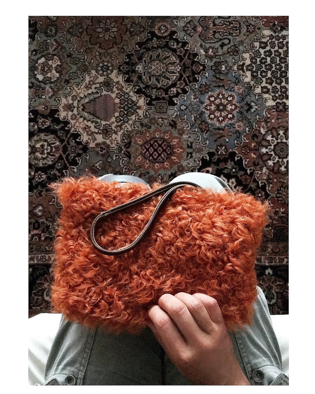 rust curly shearling pouch with brown leather wristlet. $65 (shipping included)