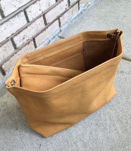 golden wheat leather spring frame clutch