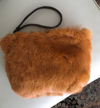 Load image into Gallery viewer, rust straight hair shearling pouch is smooth! with brown leather wristlet...the interior is a smooth leather underbelly!
