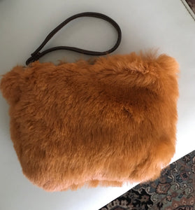 rust straight hair shearling pouch is smooth! with brown leather wristlet...the interior is a smooth leather underbelly!