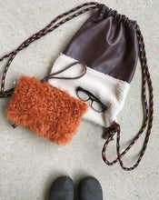 Load image into Gallery viewer, rust curly shearling pouch shown here with our leather & shearling cinch sack!