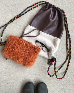 rust curly shearling pouch shown here with our leather & shearling cinch sack!