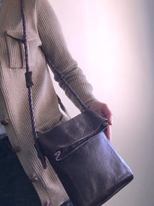 plum is a neutral...crossbody with braided strap.