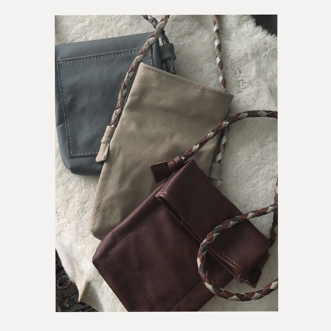 grey, taupe & cognac crossbody bags with multi colored- braided leather straps ...$155 shipped.
