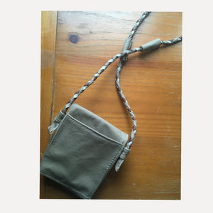 back view of taupe bag. it has an antique copper magnetic snap closure.