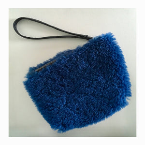 fun & cobalt!!! the interior side of this blue shearling is sueded, making it unique to the pack!