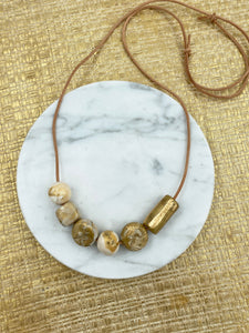 Gold Beaded Necklace - on leather