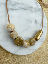 Load image into Gallery viewer, Gold Beaded Necklace - on leather