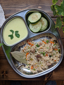 Plate pulav / pilaf with cucumber salad and kadhi