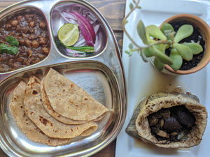 Plate of pindi chole with rotis and onion