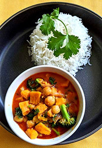 Bowl of chickpea and sweet potato curry made with SpiceFix Kashmiri Chili Powder