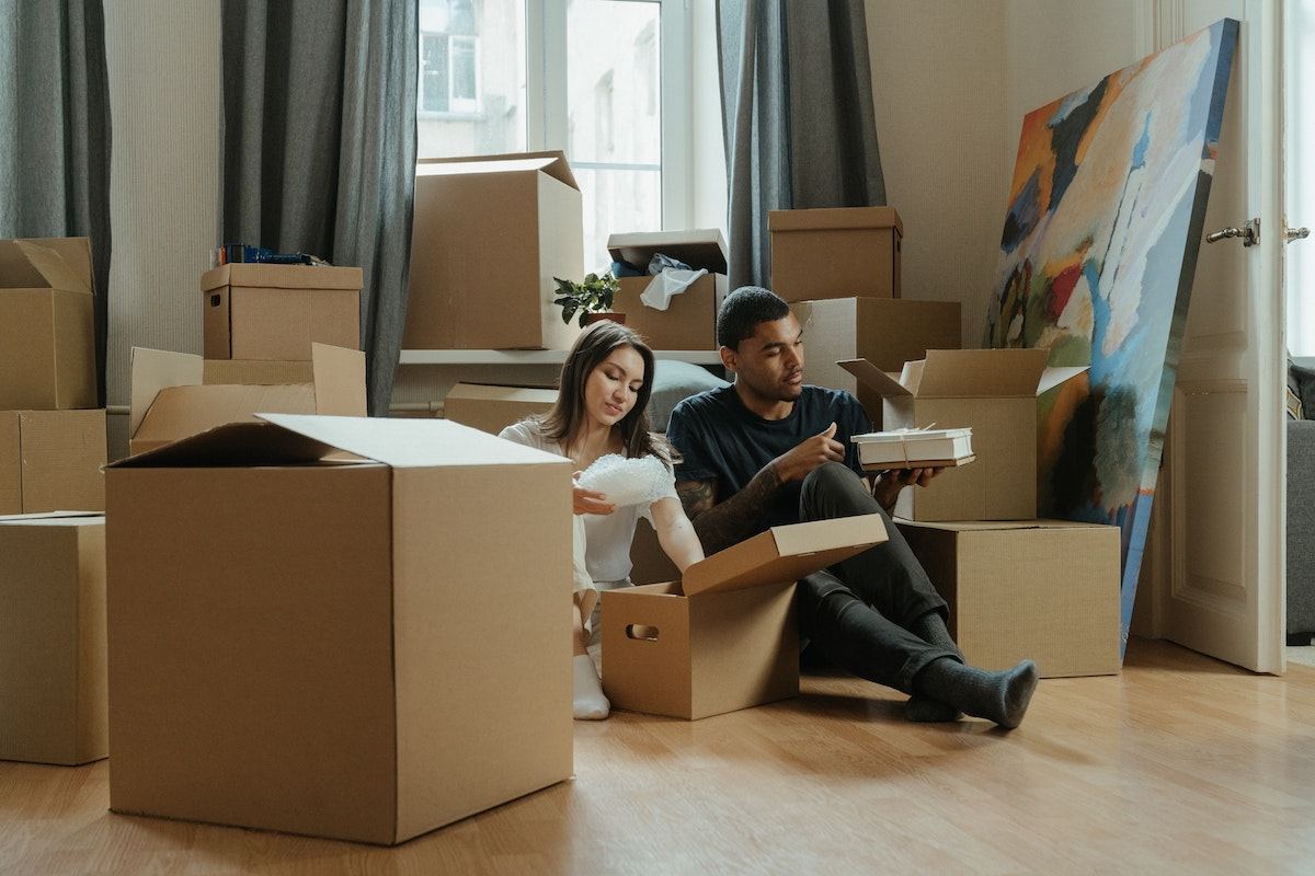 couple packing boxes for their move