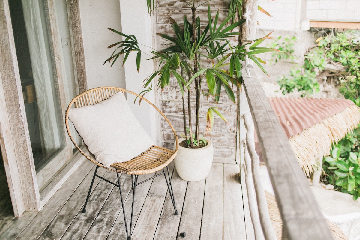 old wicker chair on porch