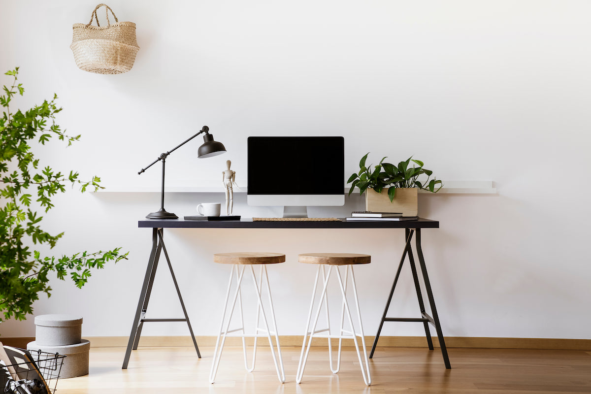aesthetic working setup with desk, computer, and chair